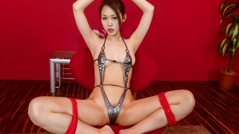 An Yabuki gives a japanese blowjob to two guys while in bondage