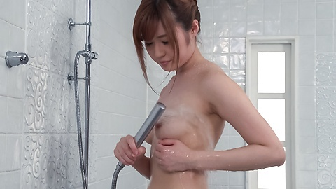 Peachy tits doll uses Japanese vibrator in the tub