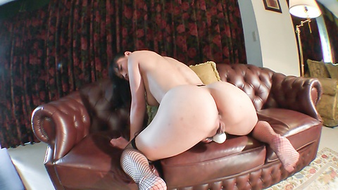 Busty Anne presents her assets in a nude solo show