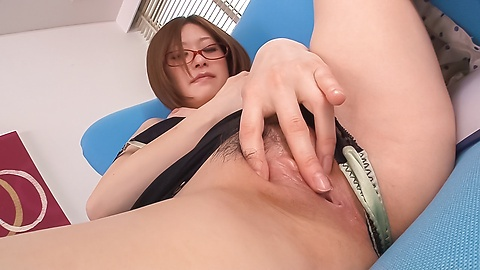 Girl with glasses plays with her warm vag
